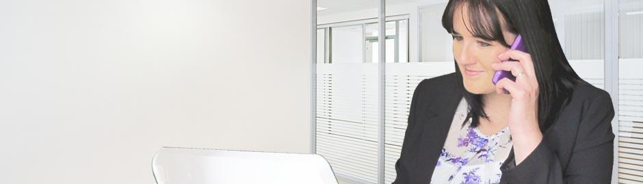 Smiling Virtual Assistant at Desk